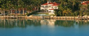 Luxury waterfront home with pool, seawall, and boat lift. Part of the home page slide show