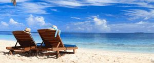 two lounge chairs on the beach. Part of the home page slide show